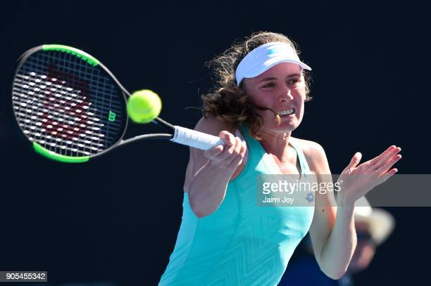 Ekaterina Alexandrova of Russia plays a forehand in her first round match against Polona Hercog of Slovenia on day two of the 2018 Australian Open at...