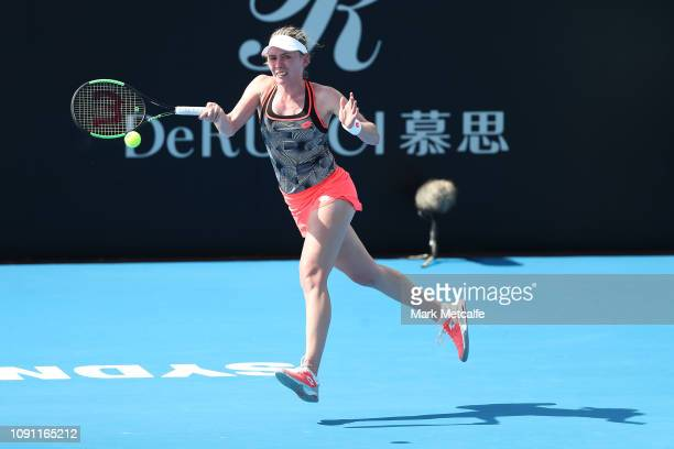 Ekaterina Alexandrova of Russia plays a forehand in her match against Sloane Stephens of the United States during day three of the 2019 Sydney...