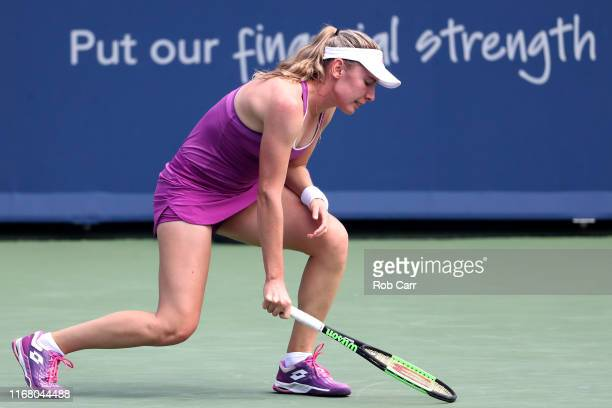 Ekaterina Alexandrova of Russia reacts to a shot against Simona Halep of Romania during Day 5 of the Western and Southern Open at Lindner Family...