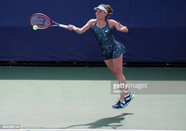 Ekaterina Alexandrova of Russia returns a shot during her first round Women's Singles match against Anna Zaja of Germany on Day One of the 2017 US...