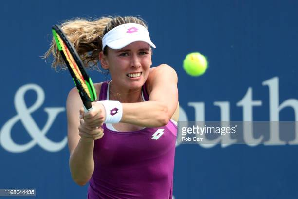 Ekaterina Alexandrova of Russia returns a shot to Simona Halep of Romania during Day 5 of the Western and Southern Open at Lindner Family Tennis...