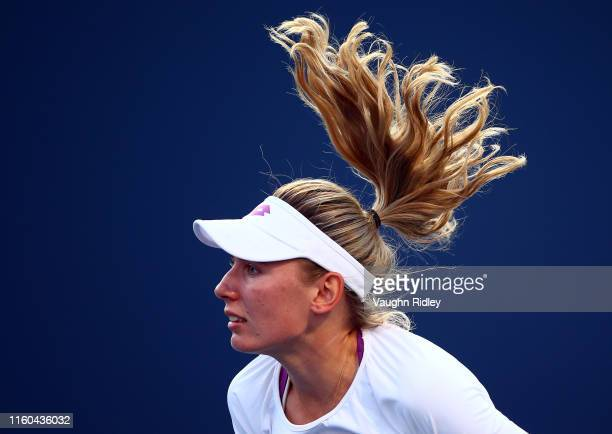 Ekaterina Alexandrova of Russia serves against Serena Williams of the United States during a third round match on Day 6 of the Rogers Cup at Aviva...