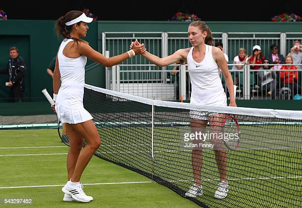 Ekaterina Alexandrova shakes hands with Madison Keys following victory in the Ladies Singles first round match on day one of the Wimbledon Lawn...
