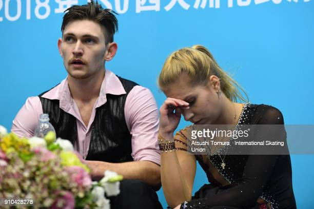 Ekaterina Alexandrovsakaya and Harley Windsor of Australia react at kiss and cry after competeing in the pairs free skating during day three of the...