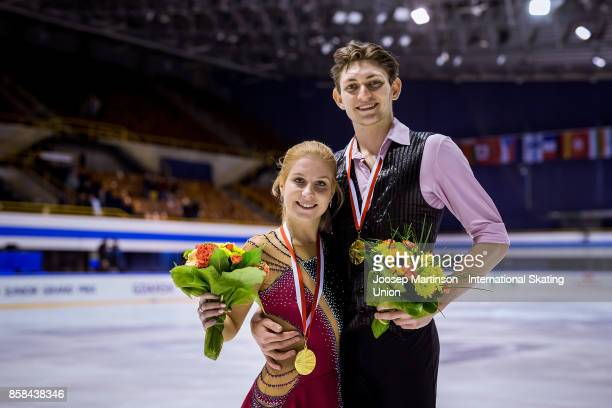 Ekaterina Alexandrovskaya and Harley Windsor of Australia pose in the Pairs medal ceremony during day two of the ISU Junior Grand Prix of Figure...