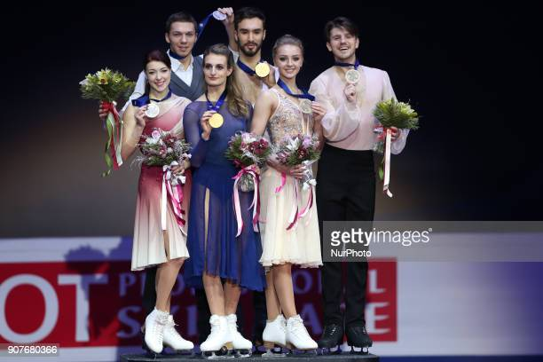 Ekaterina Bobrova and Dmitri Soloviev of Russia left and silver medalists Gabriella Papadakis and Guillaume Cizeron of France center and gold...
