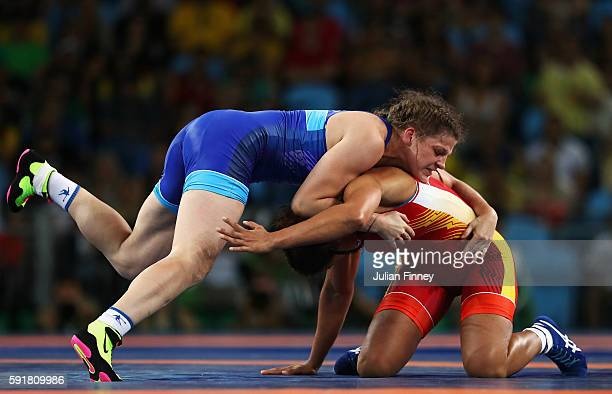 Ekaterina Bukina of Russia competes against Aline da Silva Ferreira of Brazil during the Women's Freestyle 75 kg Quarterfinals match on Day 13 of the...