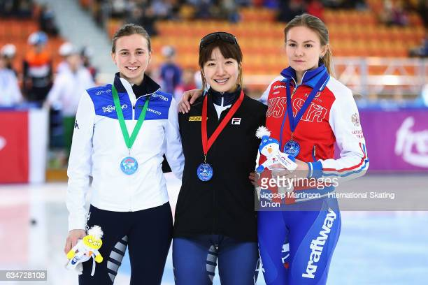 Ekaterina Efremenkova of Russia Ah Rum Noh of Korea and Lucia Peretti of Italy pose in the Ladies 1500m medal ceremony during day one of the ISU...