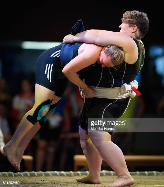 Ekaterina Gordeeva of Russia lifts Kerstin Schmidtsdorf of Germany during the Sumo Open Weight Women's Competition of The World Games at Orbita Hall...