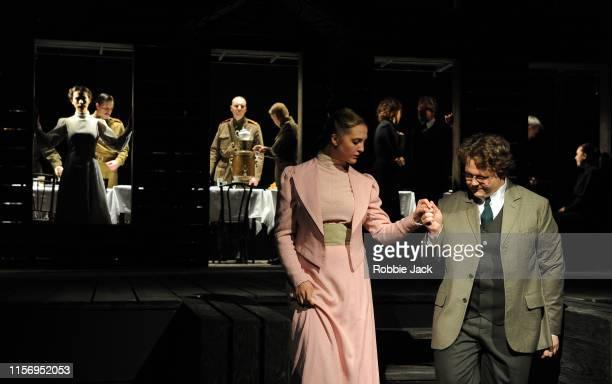 Ekaterina Kleopina as Natasha and Aleksandr Bikovskii as Andrey Prosorov with artists of the company in The Maly Drama Theatre of St Petersburg's...