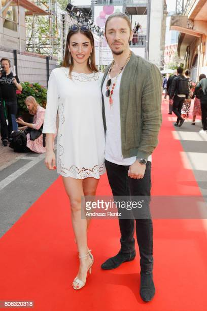 Ekaterina Leonova and Gil Ofrahim attend the Riani Fashion Show Spring/Summer 2018 at Umspannwerk Kreuzberg on July 4 2017 in Berlin Germany
