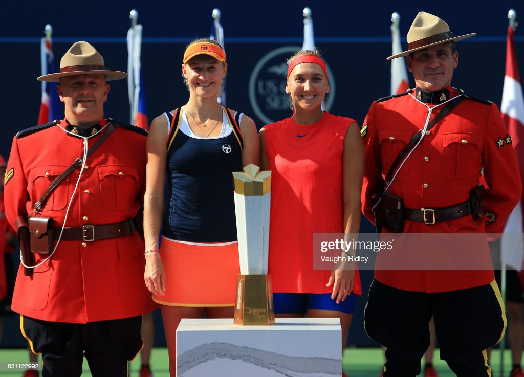 Ekaterina Makarova and Elena Vesnina of Russia and Canadian Mounties with the winners trophy following their victory over Anna-Lena Groenefeld of Germany and Kveta Peschke of Czech Republic in the doubles final match on Day 9 of the Rogers Cup at Aviva Centre on August 13, 2017 in Toronto, Canada.
