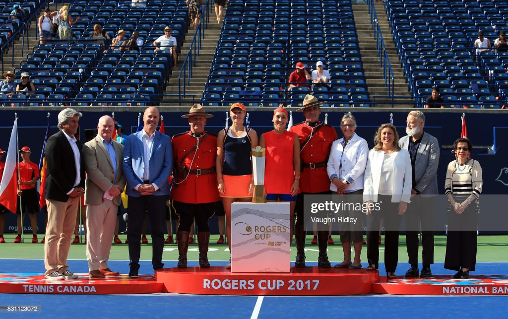 Ekaterina Makarova and Elena Vesnina of Russia and VIP's with the winners trophy following their victory over Anna-Lena Groenefeld of Germany and Kveta Peschke of Czech Republic in the doubles final match on Day 9 of the Rogers Cup at Aviva Centre on August 13, 2017 in Toronto, Canada.