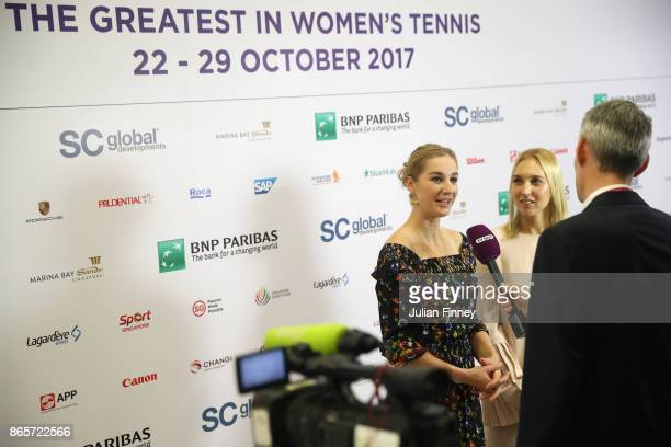 Ekaterina Makarova and Elena Vesnina of Russia are interviewed during day 3 of the BNP Paribas WTA Finals Singapore presented by SC Global at...
