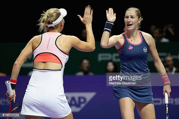 Ekaterina Makarova and Elena Vesnina of Russia celebrate a point in the doubles final match against Bethanie MattekSands of the United States and...
