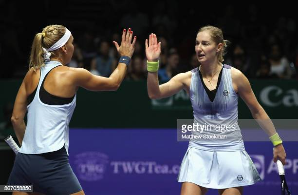 Ekaterina Makarova and Elena Vesnina of Russia celebrate a point in the doubles match against YiFan Xu of China and Gabriela Dabrowski of Canada...