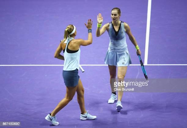 Ekaterina Makarova and Elena Vesnina of Russia celebrate a point in the doubles semi final match against Kiki Bertens of Netherlands and Johanna...