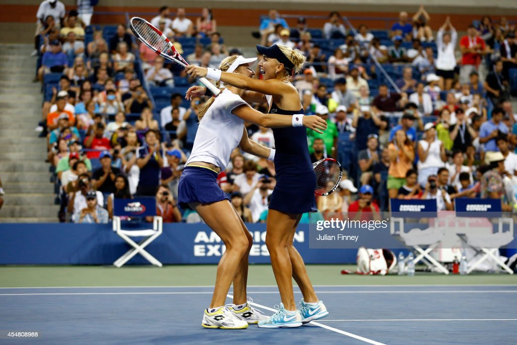 Ekaterina Makarova (L) and Elena Vesnina (R) of Russia celebrate after defeating Martina Hingis of Switzerland and Flavia Pennetta of Italy during their women's doubles final match on Day Thirteen of the 2014 US Open at the USTA Billie Jean King National Tennis Center on September 6, 2014 in the Flushing neighborhood of the Queens borough of New York City. Makarova and Vesnina defeated Hingis and Pennetta in three sets 2-6, 6-3, 6-2.