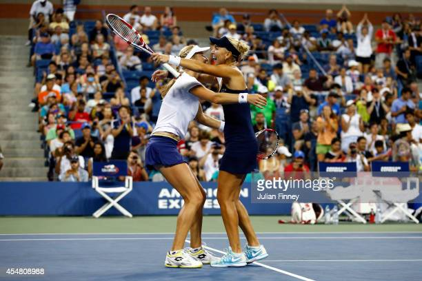 Ekaterina Makarova and Elena Vesnina of Russia celebrate after defeating Martina Hingis of Switzerland and Flavia Pennetta of Italy during their...