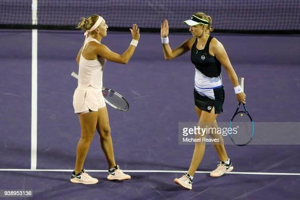 Ekaterina Makarova and Elena Vesnina of Russia celebrate against Lyudmyla Kichenok of Ukraine and Alla Kudryavtseva of Russia during Day 9 of the...
