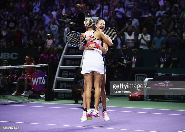 Ekaterina Makarova and Elena Vesnina of Russia celebrate victory in the doubles final match against Bethanie MattekSands of the United States and...