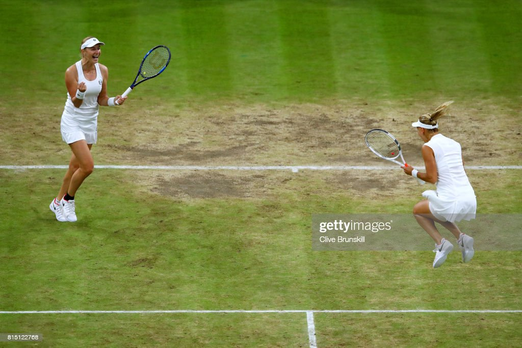 Ekaterina Makarova (L) and Elena Vesnina of Russia celebrate victory in the Ladies Doubles Final against Hao-Ching Chan of Chinese Taipei and Monica Niculescu of Romania on day twelve of the Wimbledon Lawn Tennis Championships at the All England Lawn Tennis and Croquet Club at Wimbledon on July 15, 2017 in London, England.