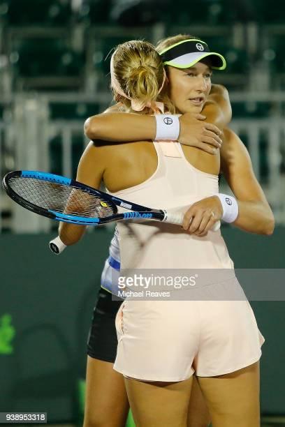Ekaterina Makarova and Elena Vesnina of Russia hug after defeating Lyudmyla Kichenok of Ukraine and Alla Kudryavtseva of Russia during Day 9 of the...