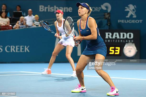 Ekaterina Makarova and Elena Vesnina of Russia in action against Sania Mirza and Bethanie MattekSands of the USA during the Women's Doubles Final on...