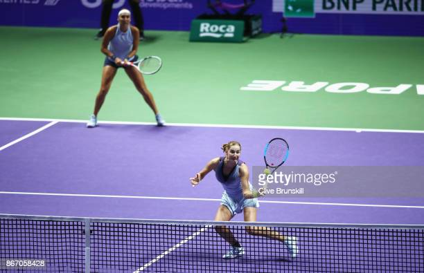 Ekaterina Makarova and Elena Vesnina of Russia in action in the doubles match against YiFan Xu of China and Gabriela Dabrowski of Canada during day 6...
