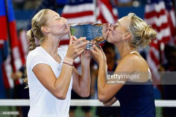 Ekaterina Makarova and Elena Vesnina of Russia kiss the trophy after defeating Martina Hingis of Switzerland and Flavia Pennetta of Italy in their...