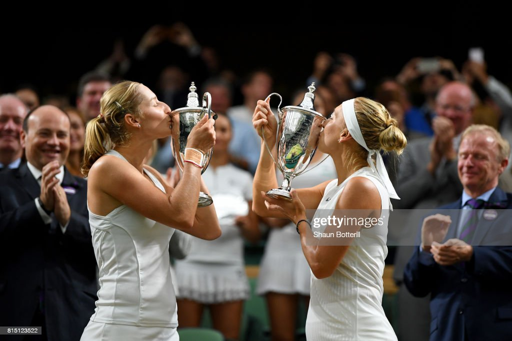 Ekaterina Makarova (L) and Elena Vesnina of Russia kiss their winners trophies after victory in the Ladies Doubles Final against Hao-Ching Chan of Chinese Taipei and Monica Niculescu of Romania on day twelve of the Wimbledon Lawn Tennis Championships at the All England Lawn Tennis and Croquet Club at Wimbledon on July 15, 2017 in London, England.