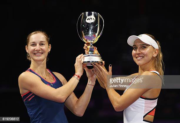 Ekaterina Makarova and Elena Vesnina of Russia pose with the trophy after victory in the doubles final match against Bethanie MattekSands of the...