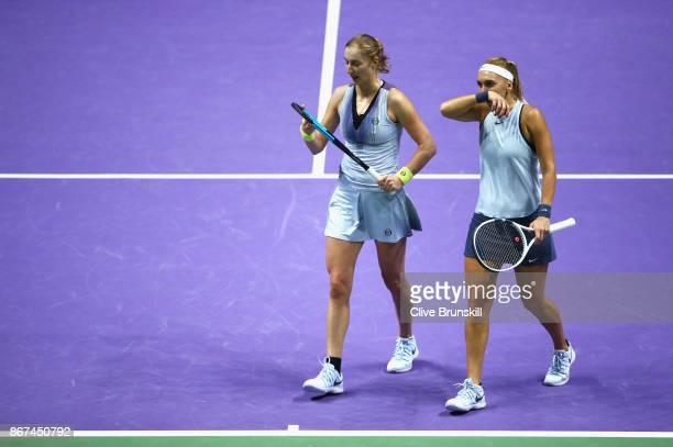 Ekaterina Makarova and Elena Vesnina of Russia talk in the doubles semi final match against Kiki Bertens of Netherlands and Johanna Larsson of Sweden...