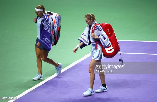 Ekaterina Makarova and Elena Vesnina of Russia walk off court after the doubles semi final match against Kiki Bertens of Netherlands and Johanna...