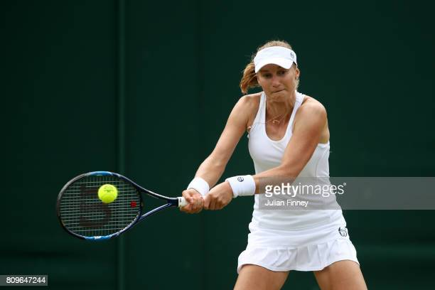 Ekaterina Makarova of Germany plays a forehand during the Ladies Singles second round match againsts Svetlana Kuznetsova of Russia on day four of the...