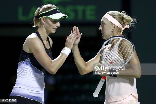 Ekaterina Makarova of Russia and Elena Vesnina of Russia celebrate a point while playing Coco Vandeweghe and Ashleigh Barty of Australia during the...