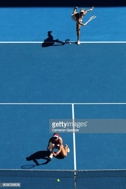 Ekaterina Makarova of Russia and Elena Vesnina of Russia compete in their women's doubles match against Yifan Xu of China and Gabriela Dabrowski of...