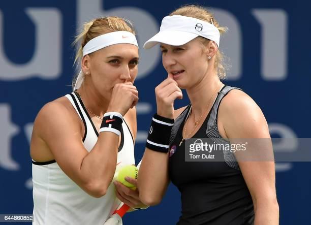 Ekaterina Makarova of Russia and Elena Vesnina of Russia discuss tactics in their semi final match against Sania Mirza of India and Barbora Strycova...