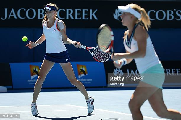 Ekaterina Makarova of Russia and Elena Vesnina of Russia in action in their fourth round doubles match against Andrea Hlavackova of the Czech...