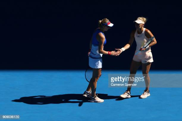 Ekaterina Makarova of Russia and Elena Vesnina of Russia talk tactics in their women's doubles match against Yifan Xu of China and Gabriela Dabrowski...
