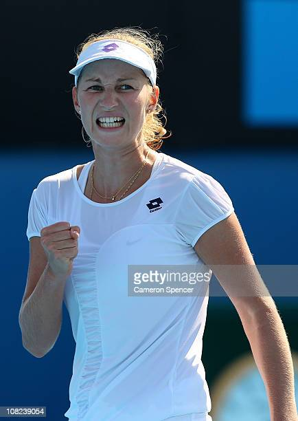 Ekaterina Makarova of Russia celebrates a point in her third round match against Nadia Petrova of Russia during day six of the 2011 Australian Open...