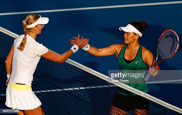 Ekaterina Makarova of Russia celebrates shakes hands with Grace Min of the United States after defeating her in their women's singles first round...