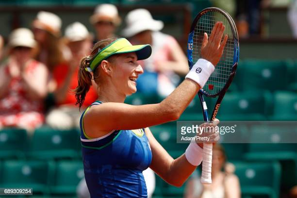 Ekaterina Makarova of Russia celebrates victory after the ladies singles first round match against Angelique Kerber of Germany on day one of the 2017...