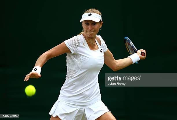 Ekaterina Makarova of Russia during the plays a forehand against Johanna Larsson of Sweden on day four of the Wimbledon Lawn Tennis Championships at...