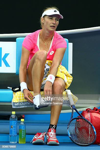 Ekaterina Makarova of Russia feels for her ankle after injuring it in her fourth round match against Johanna Konta of Great Britain during day eight...