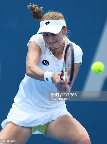 Ekaterina Makarova of Russia hits a return against Carla Suarez Navarro of Spain during their women's singles match on day three of the Sydney...