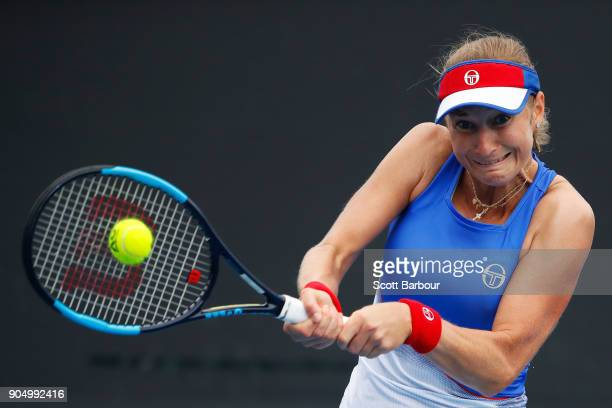 Ekaterina Makarova of Russia plays a backhand in her first round match against IrinaCamelia Begu of Romania on day one of the 2018 Australian Open at...