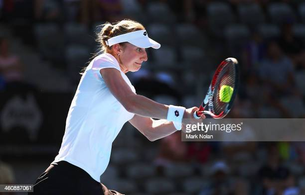 Ekaterina Makarova of Russia plays a backhand in her match against Jelena Jankovic of Serbia during day two of the Sydney International at Sydney...