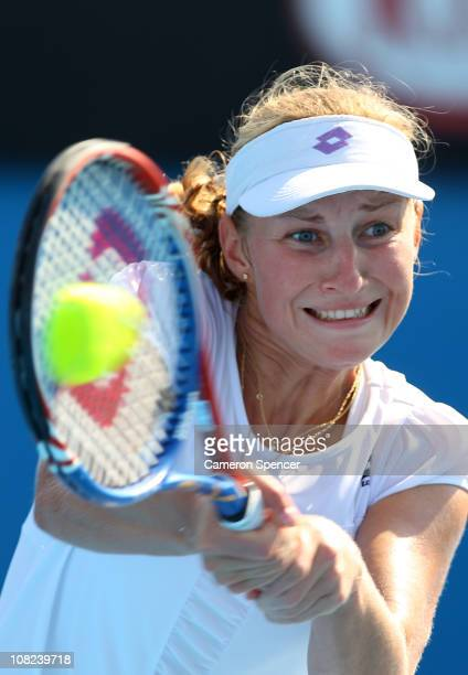 Ekaterina Makarova of Russia plays a backhand in her third round match against Nadia Petrova of Russia during day six of the 2011 Australian Open at...