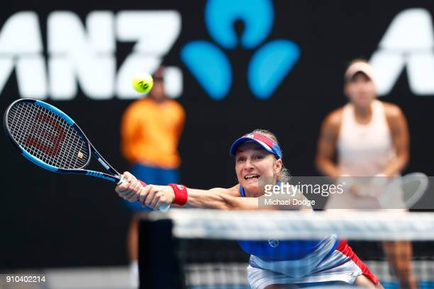 Ekaterina Makarova of Russia plays a backhand in the women's doubles final with Elena Vesnina of Russia against Timea Babos of Hungary and Kristina...